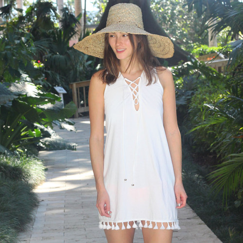 The Koru Beach Dress is made of a light weight organic cotton and has a relaxed fit.  It has an adjustable lace tie in the front with stainless steel accent beads.The bottom of the dress is accented with tassels.