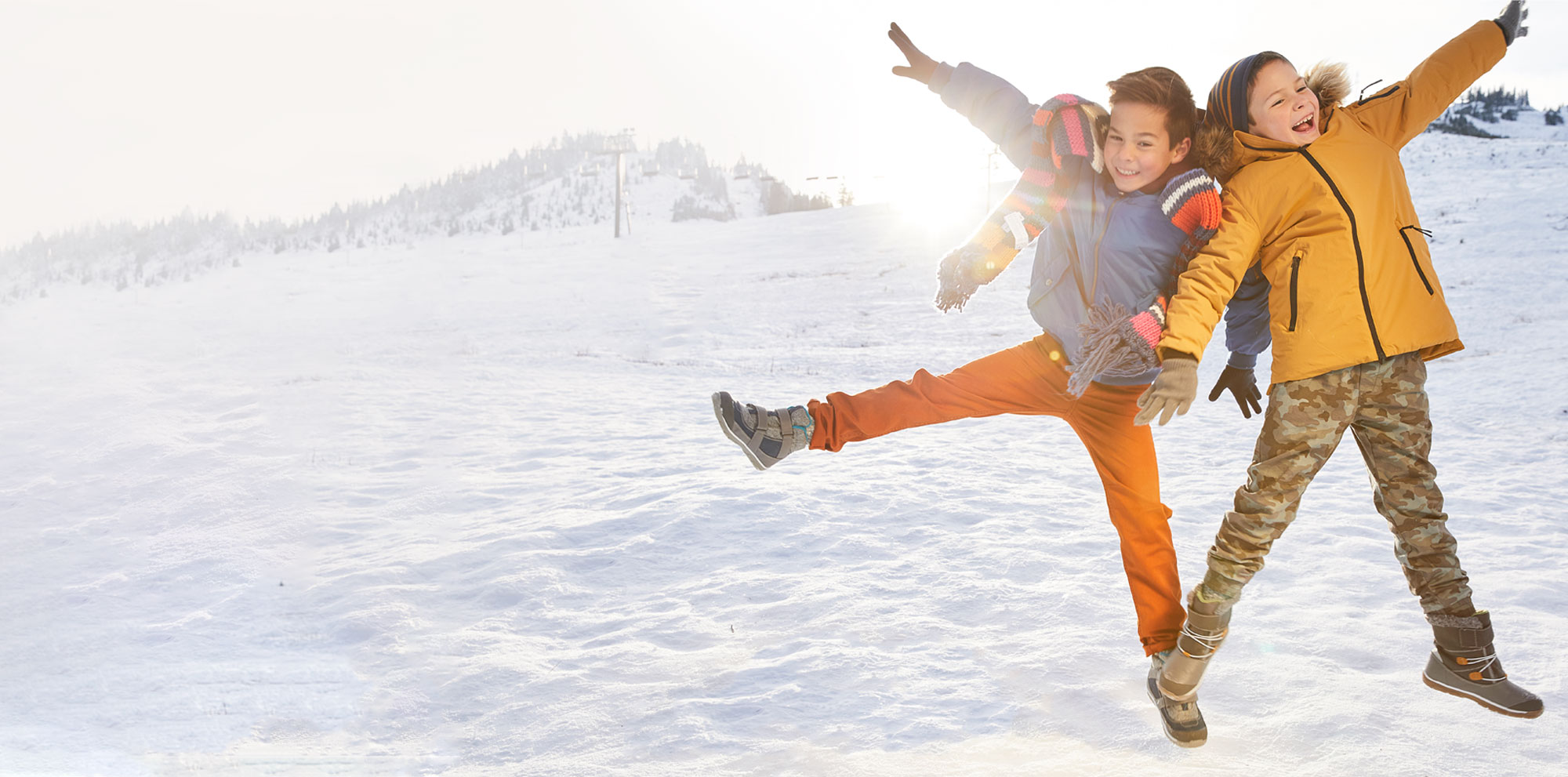 Kids playing in the snow wearing waterproof and insulated boots.