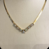 A Opal and Diamond Yellow 14K Gold Necklace.  Gorgeous with seven colourful opals and multiple pretty diamonds.  Accompanied by an independent gemological appraisal which says it all.  A great investment and lovely to wear.  JN64225  Ibon Antiques 10423 79 Avenue  in Edmonton's Old Strathcona neighborhood.