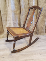 Dark stained nursing rocker with caned seat