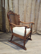 Arm chair with wicker back and cushion.