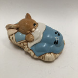 """Pendelfin rabbit """"Peeps"""" in bed with blue cover, one eye open"""