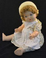"This vintage/antique Canadian Reliable doll comes with a yellow floral dress, apron, and adorable yellow knitted cap.   This vintage composition doll dates back to the 1920s.     It is in very good condition with some minor wear to her extremities commensurate with age.  Makes a ""crybaby"" sound when burped.  Complete with closing grey eyes.   Measures 19"" in height.   TY51377"