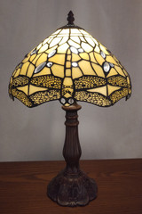 Tiffany style stained glass table lamp - cream coloured dragonfly design