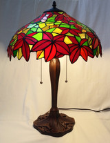 """Tiffany style stained glass table lamp - poinsettas, 16"""" diameter."""