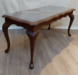 Dark coffee table, glass top, Queen Anne style legs, carved edges
