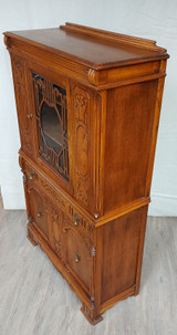Oak China Cabinet, medium colour, drawer, glass doors, carved decorations on front