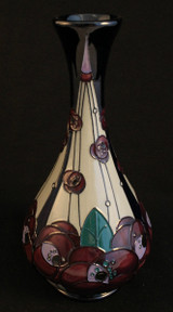 A 9 inch high vase by Moorcroft in the ''Rennie Rose'' pattern from senior Moorcroft artist, Rachel Bishop, 2015.  Inspired by the designs of art deco artist, Rennie Mackintosh.