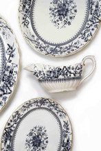 3 antique graduated platters and one gravy boat (1884)