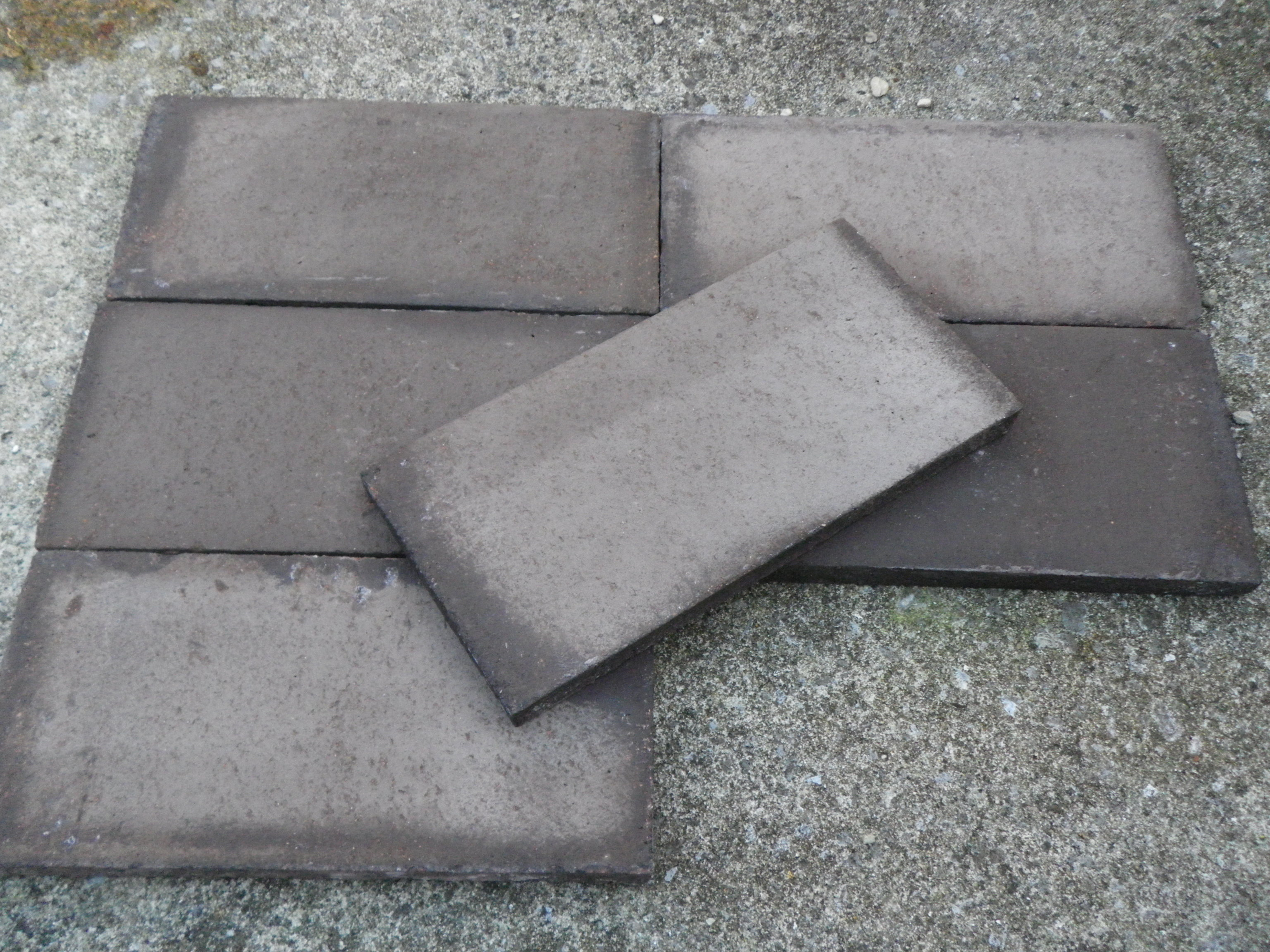 black-handmade-terracotta-unsealed.jpg