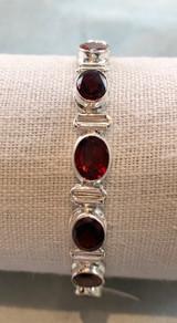 Faceted Oval Garnet Hinge Silver Bracelet