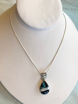 Onyx, Turquoise, and White Buffalo Inlay Silver Pendant by Cathy Webster