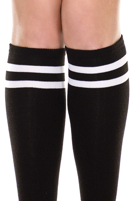 Women's knee high black socks with white stripes on top