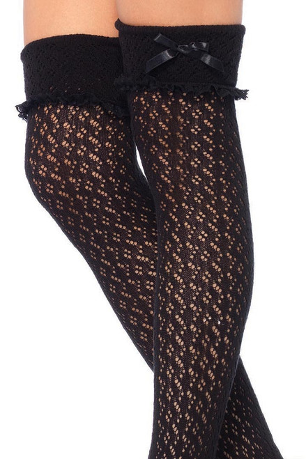 Shop these comfy black crochet thigh high socks with black lace trim and black satin bows and eyelet knit detail
