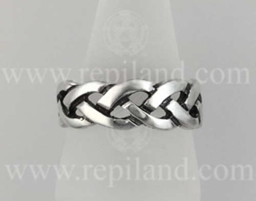 Heavy, pierced braided knotwork band.
