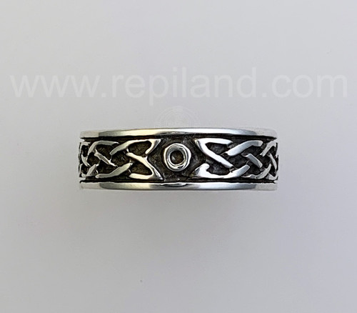 The Sior Ring has a rimmed band with knotwork framing a center circle.