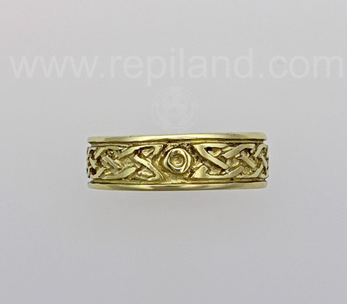 Rimmed band with knotwork framing a center circle.