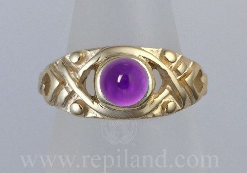Ladarna Ring, top view of ring with round gem centered like eye ball in pattern with keyholes and beads.