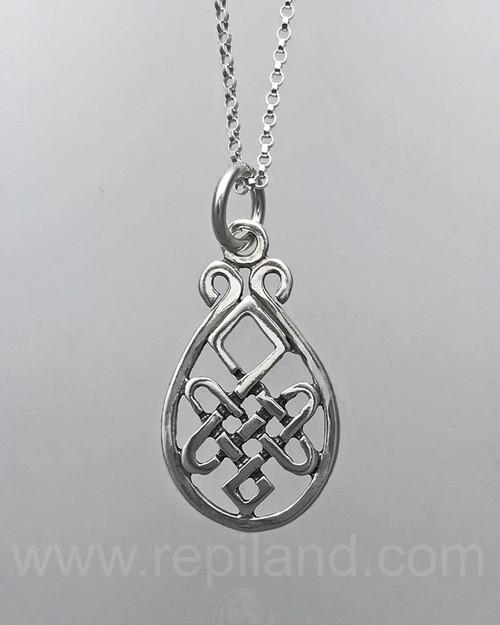 Pendant with intricate knotwork inside a teardrop shape frame