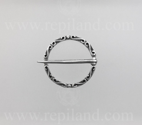Annular brooch with S curves and bead accents.