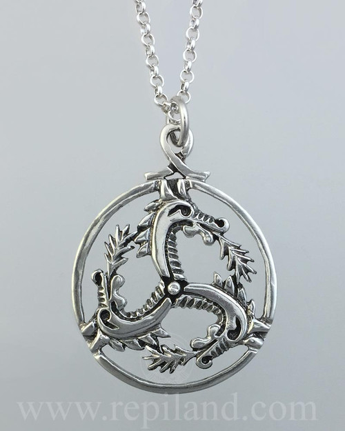 Circular sterling triskele pendant with dragon heads.