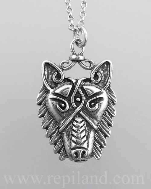 Detailed wolf head pendant.