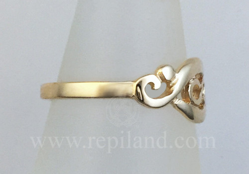 Gwenllian Ring, infinity knot enclosed within graceful curved lines, side view.