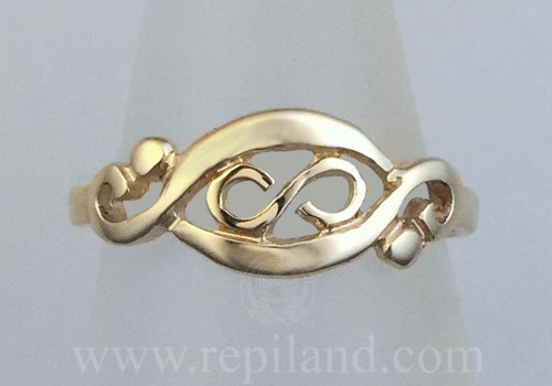 Gwenllian Ring, infinity knot enclosed within graceful curved lines, yellow gold.