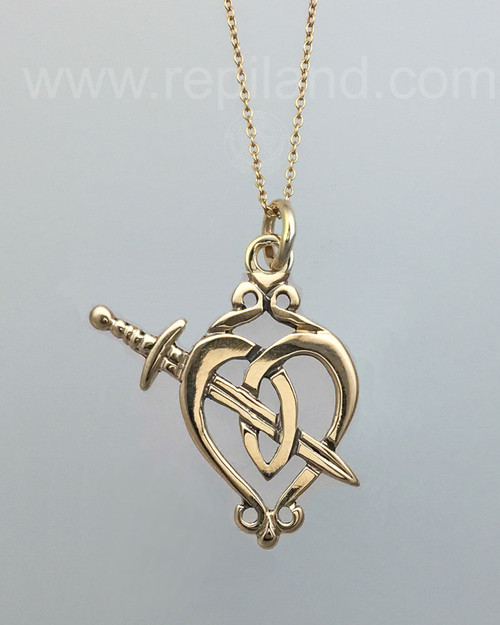 Heart shape pendant with decorative scroll at top and sword crossing the heart.