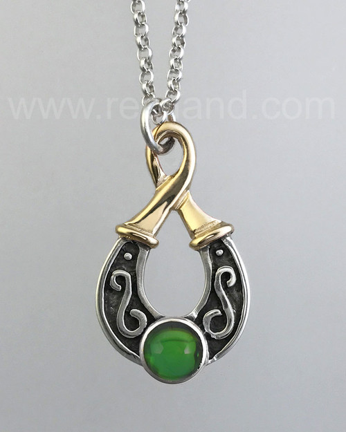 Teardrop shaped pendant with an 8mm gemstone. Yellow gold & sterling.
