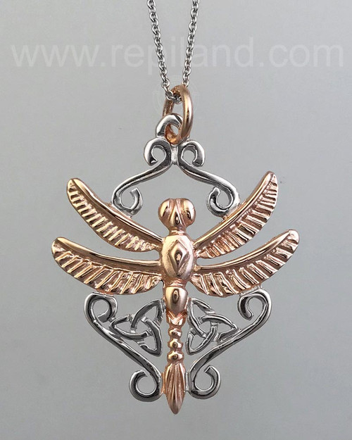 A dragonfly with trinity knots and scroll work.