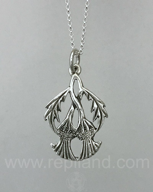 Pendant with two twined thistle plumes with arching leaves on the sides.