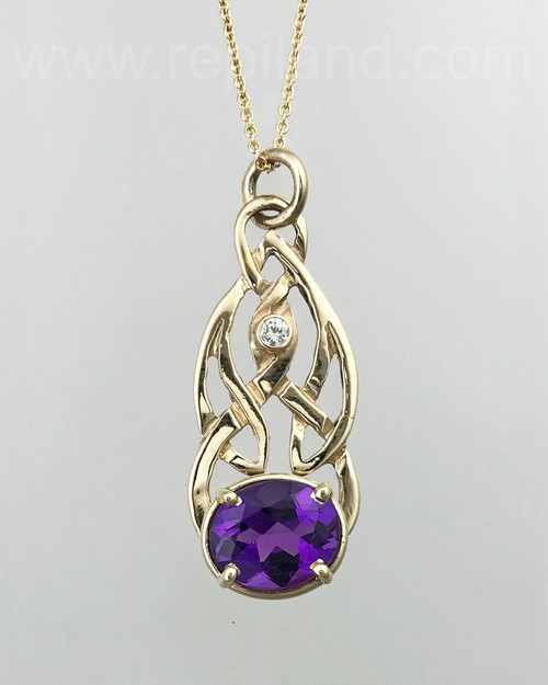 14kt yellow gold pendant with a 4.39ct Amethyst & 10pt White Diamond.