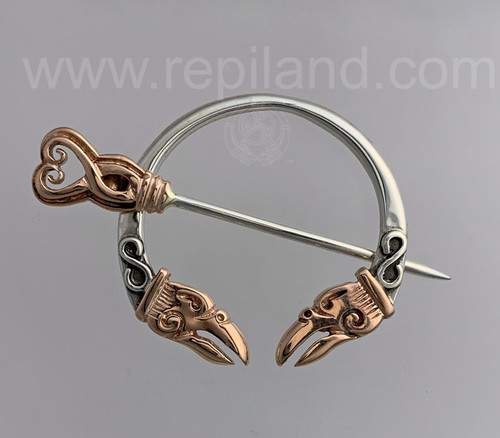 The Orkney Penannular has raven heads facing inward. Rose gold & sterling.