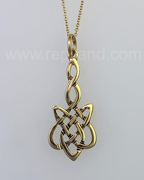 The Sionnach Knot Pendant has a twined stem that drops into a wider knot below.