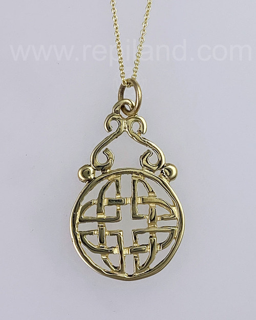 The Targe Knot Pendant has a bead and graceful elongated S-curve that come up and meet at the top making a triangular shape above the circular framed shield knot. Yellow gold.