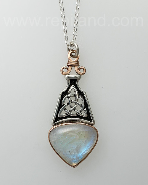 Sterling & 14kt rose gold pendant with 20.57ct Rainbow Moonstone.