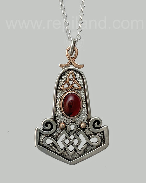 Hammer pendant with Garnet.