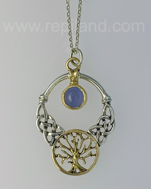 The Oak Grove Gem Pendant features knotwork, a tree and an 8mm gemstone, yellow gold & sterling with Blue Topaz.