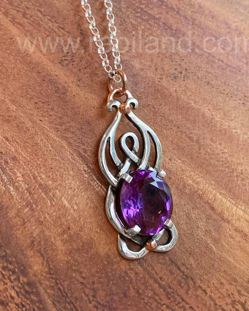 Sterling & 14kt Rose gold pendant with 9.72ct Amethyst.