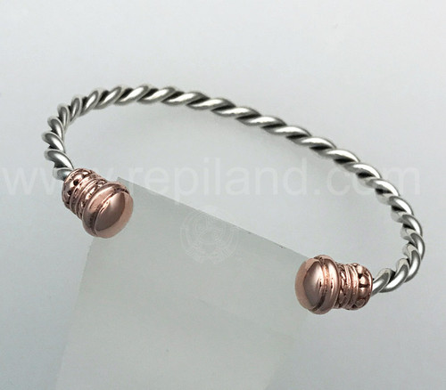 The Essylt Wrist Torc features alternating smooth and beaded rings and is capped with a smooth polished end.
