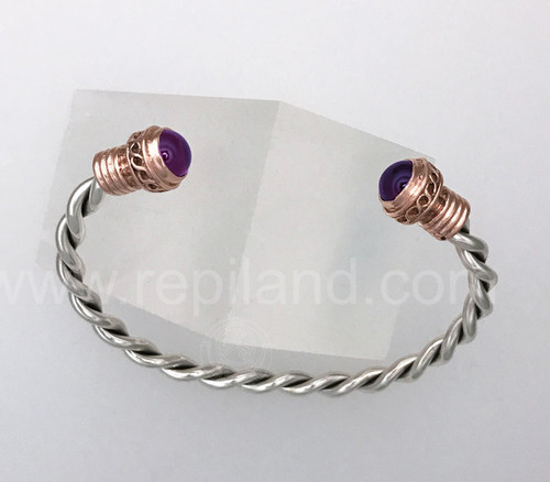 The Gemstone Wrist Torc features 8mm gemstones with a decorative infinity chain and grooved collar.