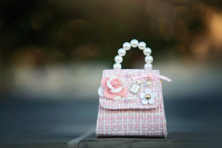 PINK BOUCLE PEARL HANDLE PURSE