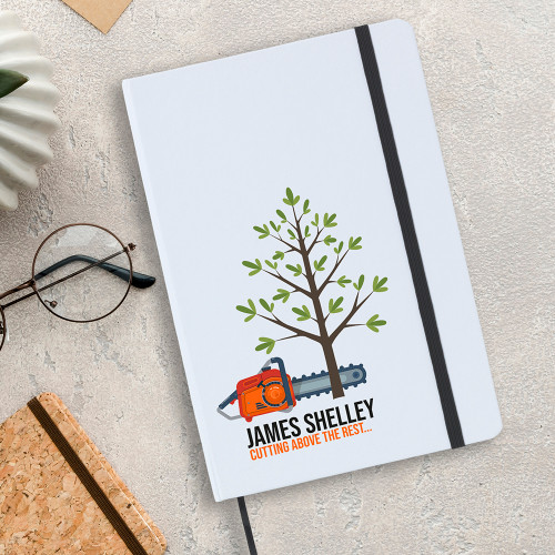 Cutting above the rest A5 notebook with a tree and chainsaw design.