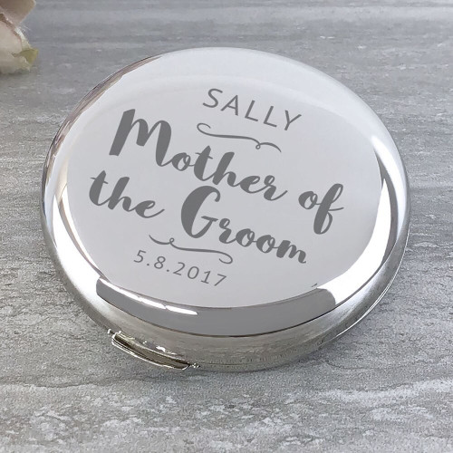 Mother of the groom, compact round mirror.