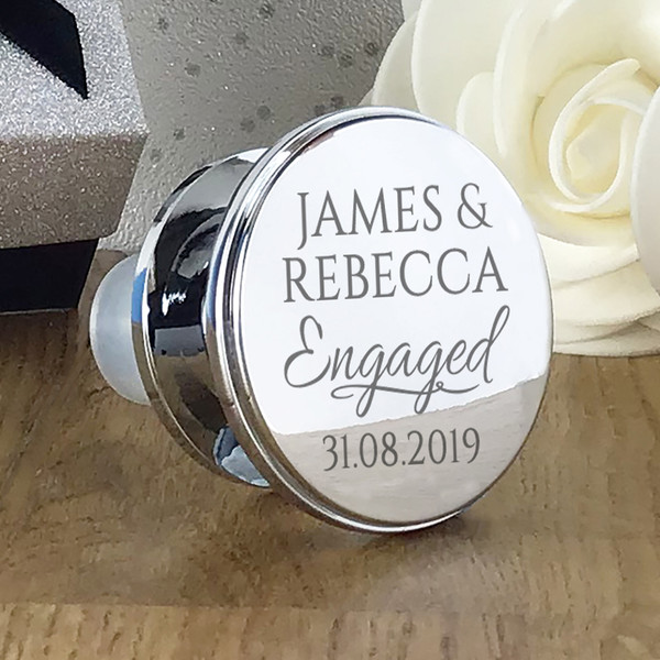Engraved, silver plated wine stopper . Personalised with couples names and engagement date.