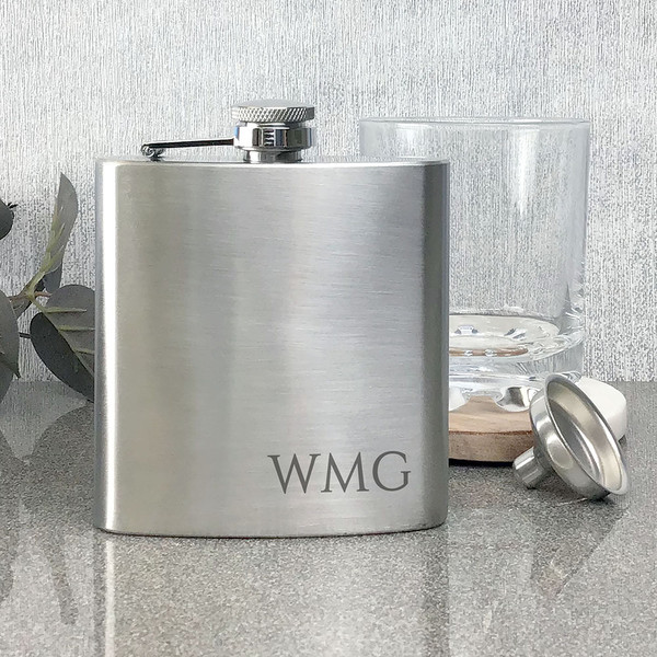 Stainless steel hip flask with engraved initials onto the front.