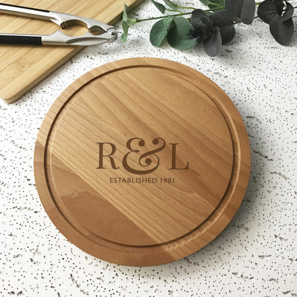 Laser engraved solid beech wood chopping board/cheese board/bread board personalised with initials.