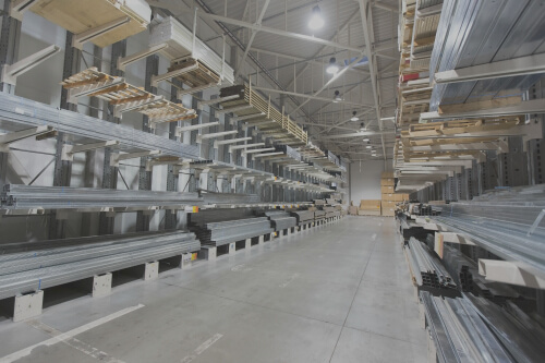 Large commercial warehouse with stainless steel panels visible