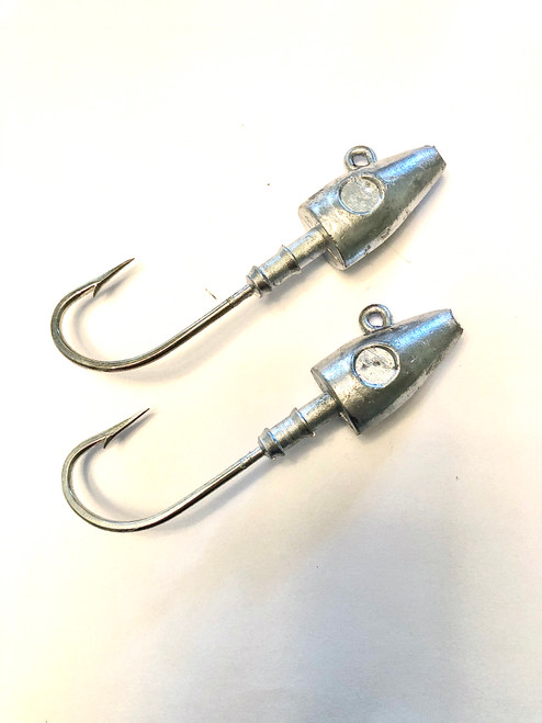 2oz built with a 8/0 Mustad Hook 3 to 6 oz built with a 9/0 Mustad Hook